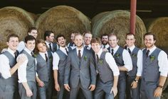 Groomsman in light grey vest suit with burgundy tie. ....would use different flowers!