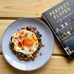 Chickpeas with roasted shallots chard & coriander fried egg & harissa with a side of @johnwhaitebakes . Cracking book mate that brown butter tart is getting MADE  by dandoherty_
