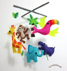 Baby Crib Mobile - Baby Mobile - Felt Mobile - Nursery mobile - Jungle Theme tropical bird Mobile (Custom color available). $78.00, via Etsy.