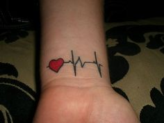This would be really cool tattoo from heart beat of child during ultrasound with kids name in the heart. Living or angel baby tattoo for mom.