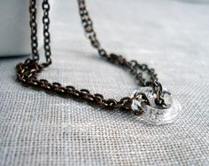 Copper chains and swarovski crystal ring necklace.  $47