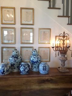 Hand penned antiqued letters framed.....with blue and white and wood....