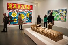 'Keith Haring' Exhibition Preview in Paris Visitors standing in front of a Keith Harring painting during a press preview at Musee d'Art Moderne on April 18, 2013 in Paris, France.