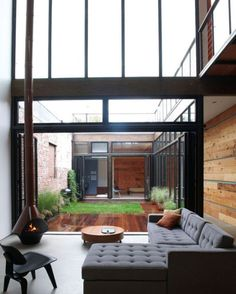 love the couch and table, wood walls, atrium, light...