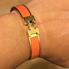 Authentic Hermes Clik Clack Orange Bracelet AUTHENTIC Hermes Clik Clak Orange Bracelet, all reasonable trades considered, will trade for Michael Kors Bag, MAC makeup Lot, Nike Huarache Shoes Size 7, please do not ask if it is authentic, it is listed as such I received as a gift and don't wear orange. I do not have the dust bag or box, AS IS! DO NOT LOWBALL, the price is a significant discount already. Trade Value 300.00 USD! Hermes Jewelry Bracelets