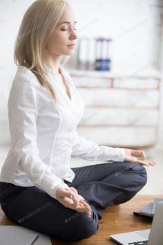 Business woman sitting in padmasana pose photo by fizkes on Envato Elements