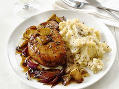#FNMag's Pork Chops With Apples and Garlic Smashed Potatoes is a company-worthy meal but simple to prepare.