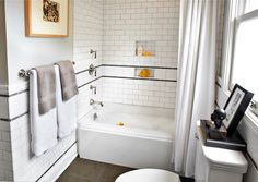 Laura Martin Bovard Interiors: Yellow and gray bathroom design with drop-in tub paired with subway tile shower surround ...