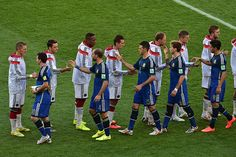 The two teams shake hands before kick-off