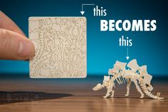 A small laser-cut piece of paper is turned into a dinosaur skeleton model.