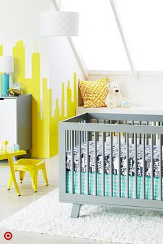 Looking for a sophisticated, fun twist to Baby's room? Check out the Oh Joy! City Nursery Collection, created by designer and blogger Joy Cho. You'll love the 4-pc. crib bedding set, a black-and-white cityscape with touches of mint. Plus you'll find swaddles, blankets, toss pillows and decor, all easy to add to your registry. (And, if you're looking for furniture, the Babyletto Hudson crib and dresser shown are nice options.) DIY tip: paint a city skyline on the wall to match the urban…