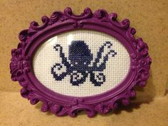 Finished blue Octopus cross stitch in small by SkeletonHearts