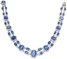 PLATINUM AND SAPPHIRE NECKLACE, VAN CLEEF & ARPELS, FRANCE, CIRCA 1950, Of flexible design, set with 34 oval and cushion-cut sapphires weighing approximately 150.00 carats, framed and accented by numerous round diamonds weighing approximately 25.00 carats, length 15 inches, Van Cleef & Arpels signature obscured, with French assay marks.