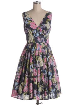 Indie, Retro, Party, Vintage, Plus Size, Convertible, Cocktail Dresses in Canada May Flowers Dress - Your flower garden is jealous of your beautifully printed navy floral all cotton dress. A-line with pleated skirt and a v-neckline. Fits large! 100% cotton. Not stretchy. Lined. Side zipper. Styling Tip: Easy to layer with a cream cardigan for extra warm, or pair with heels for a classy day look!