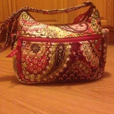 100% real Vera Bradley bag. 100% real Vera Bradley Over the shoulder tote bag. Pink swirl design. adjustable arm strap. Many places to store things. Great on the go bag. Vera Bradley Bags