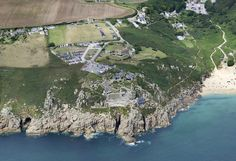 Porthcano & The Minack Theatre aerial image by John Fielding #porthcano #minack #theatre #coast #aerial #coast #cornwall