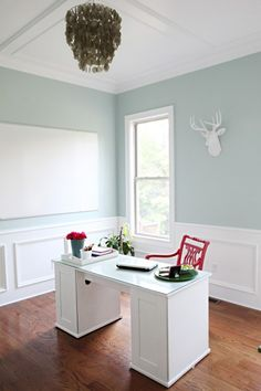 Coffered ceiling with moulding panels on the walls. Paint color is Woodlawn Blue by Benjamin Moore.