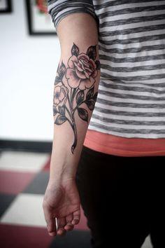 A twist to the traditional rose tattoo. I think I like forearm tattoos.