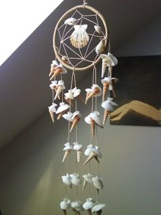 seashell dream catcher | And candlesticks decorated with shells from the same store: