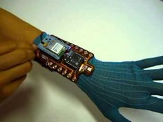 First prototype of a wireless data gloves incorporating an IMU, e-textile sensors to measure finger flexion, and an RGB LED and 2 vibration motors for visual and haptic feedback. (june 2013)