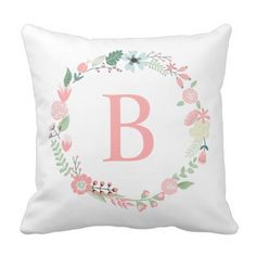 Delicate Floral Monogrammed Wreath Throw Pillows. a lovely white pillow with delicate watercolor pastel floral wreath in the center. A soft pink letter is the pillows focal point. You can of course change the monogram to suit your own needs.