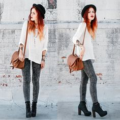 Flowy white top. Gray acid-washed skinny jeans. Black boots. Brown bag. Black bowler hat.