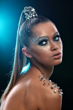 Gorgeous make-up and eye lashes  	accentuated with crystals galore!