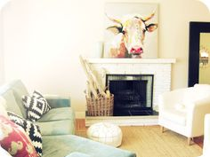 Bright living room with a painted fireplace