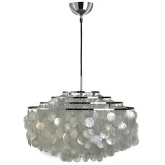 The Pendant Light Fun 10DM, Mother of Pearl - Shell Lamp, from VerPan, Designed in 1964 by Verner Panton, looks more like a lighting object, than like a normal lamp.