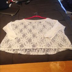 Lace three quarter sleeve top Pretty see through lace top that dresses up any pair of jeans or pencil skirt. Looks great with a turtleneck,  cam I or a bandeau underneath. Will fit almost any s/m or large. I am 32dd and it has a good amount of room and still hits at the low waisted jean area. You are not alone Tops Tees - Long Sleeve