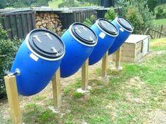 Garden Plans a row of compost tumblers DIY - Today's Gardens.Garden Plans a row of compost tumblers DIY - Today's Gardens Garden Compost, Garden Beds, Vegetable Garden, Terrace Garden, Farm Gardens, Outdoor Gardens, Urban Farming, Garden Projects, Garden Tools