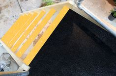 Slippery timber platforms made safe with floor sheets and stair nosing.