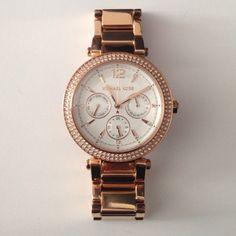 Rose Gold Michael Kors Watch Barely worn, beautiful rose gold watch Michael Kors Accessories Watches