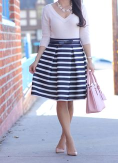 Striped Pleated Tulip Skirt, bow belt, blush sweater, statement necklace, pink purse and pumps // Click the following link to see outfit details and photos:  http://www.stylishpetite.com/2015/03/striped-pleated-tulip-skirt-and-blush.html