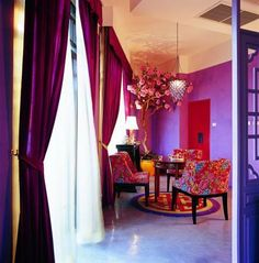 Morrocan colors - love the color of the drapes and chairs