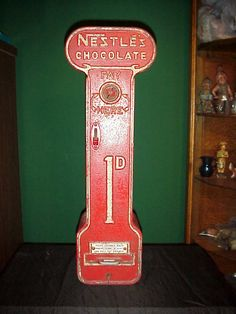 Nestle's Chocolate Vending Machine, Nestle Chocolate Vending Machine. Withe original lock and key. $1,950..., https://www.gameroomshow.com/product/vintage-vending-machines/nestles-chocolate-vending-machine/, 1950,