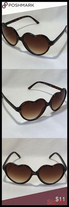 as described Black Dolity Unisex No Frame Rimless Sunglasses Heart Shape Transparent Glasses Candy Color