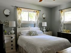 Nice headboard and nightstands against pale gray/blue and yellow
