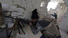 Rebel fighters take aim at government forces in Handarat, north of Aleppo (1 March 2015)