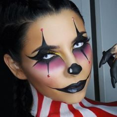 halloween face paint, young woman with clown makeup, in black and purple, wearin. - Maquillage halloween - Make up Spooky Halloween, Rosto Halloween, Halloween Looks, Halloween Painting, Halloween Face Paint Scary, Halloween Customs, Halloween 2017, Maquillage Halloween Clown, Visage Halloween