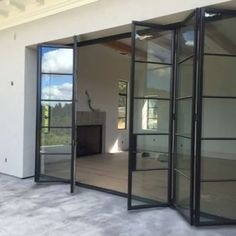 We have a large selection of custom contemporary, modern, and European bifold doors to suit everyone's taste. Bifold Exterior Doors, Bifold Doors Onto Patio, Exterior Doors With Glass, Sliding Glass Door, Bi Fold Patio Doors, Bifold Glass Doors, Bi Folding Doors, Steel Frame Doors, Steel Doors And Windows