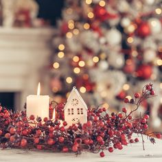 Candles and Christmas decoration on table over blurred evening lights background;