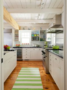 Stunning kitchen - love the open beam ceiling and open shelving