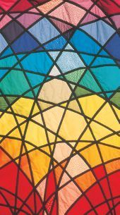 Quilt showing movement through the colour wheel, by Gail Lawther