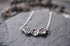 Three silver flowers necklace £23.00