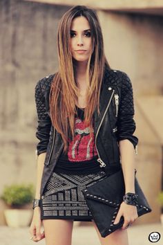 Moto jacket X The Rolling Stones shirt X Studded mini skirt...we are in love with this look! #Lookbook #RockerFashion