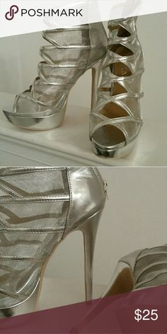 cec3d204a3176 Shop Women s Paper Fox Silver size 10 Heels at a discounted price at  Poshmark.