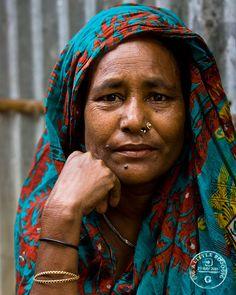 A woman in the slums of Sylhet, Bangladesh. by Rowan Gillson, via Flickr