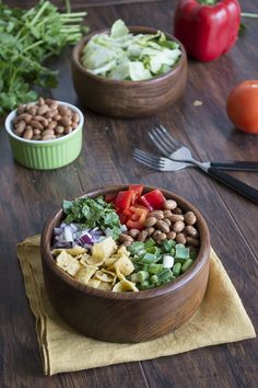 Tex Mex Frito Salad - sub black beans, add yellow rice, Green Giant frozen roasted corn and pepper mix, Annie's Red Bell Pepper dressing