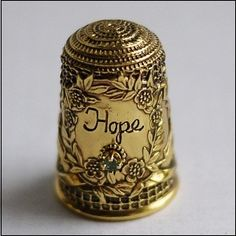 thimble...Hope    (.....cr....i love this thimble because it makes me think of the old hymn....My Hope is Built on Nothing Less....than Jesus blood and righteousness....etc., etc.)